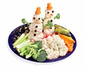 picture of enticing  - A veggie platter with cute edible snowmen to make it more enticing - JPG