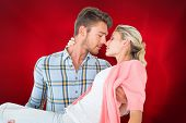 image of pick up  - Composite image of handsome man picking up and hugging his girlfriend - JPG
