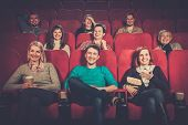 picture of watching movie  - Group of smiling people watching movie in cinema - JPG