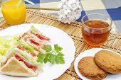 pic of sandwich  - Huge breakfast with sandwich orange juice sweet and tea - JPG