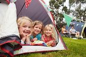 image of grassland  - Family Enjoying Camping Holiday On Campsite  - JPG