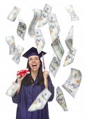 stock photo of white gown  - Excited Female Graduate in Cap and Gown Holding Stack of  - JPG