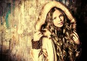 picture of coat  - Fashion shot of a pretty teenager girl with beautiful long curly hair wearing fur coat - JPG