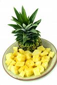picture of flesh  - Pineapple with skin green cutting the flesh on a plate yellow top photo at close range on a white background isolation - JPG