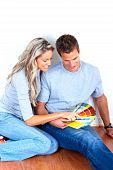 stock photo of interior decorator  - smiling couple choosing color for the interior wall of home - JPG