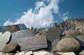 image of tibetan  - Tibetan prayer stones with mountains and blue sky - JPG