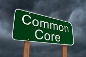 foto of common  - Common Core Sign Green highway sign with words Common Core with stormy sky background - JPG