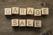 picture of yard sale  - Garage Sale text on a wooden background - JPG
