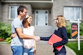 stock photo of residential home  - Happy Family near new home - JPG