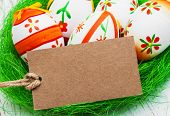 foto of easter card  - Easter greeting card with easter eggs on a old wooden background - JPG