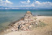 picture of siberia  - Old damaged stone pier at Baikal Lake situated in Siberia - JPG
