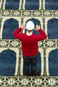 stock photo of muslim kids  - Photo of the Young muslim man showing Islamic prayer - JPG