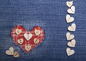 stock photo of applique  - Heart symbol in denim trimmed with other tissue. Applique card for congratulations.