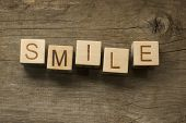 stock photo of slang  - smile word on toy bricks on the table - JPG