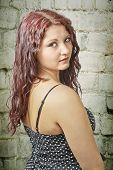 image of wench  - View portrait of young girl in front of a brick wall - JPG