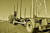 picture of logging truck  - truck with trailer and timber loading crane