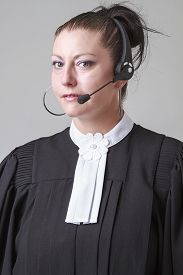 image of toga  - Woman in her thirties wearing canadian lawyer toga and a phone headset - JPG