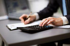 stock photo of retirement  - Man doing his accounting financial adviser working - JPG
