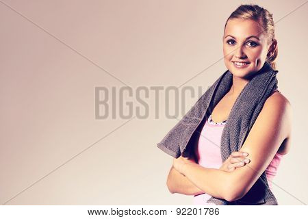 Young fitness woman posing with arms crossed