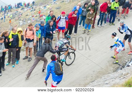 Tour Of Italy: Supporter Pushing Cyclist On Mountain Road