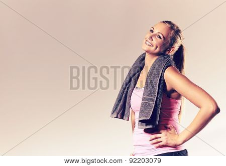 Woman Wearing Workout Clothes Posing With Head Tilted Back.