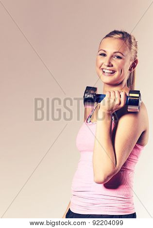Woman Smiling And Holding A Free Weight.