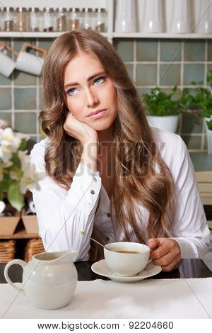 Sad Woman Drinking Coffee