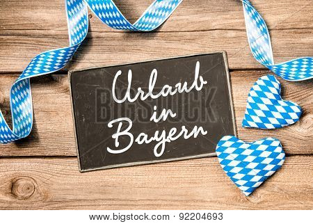 Board with German text Holidays in Bavaria