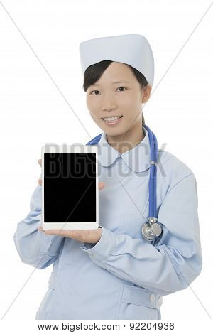 Asian Nurse Holding Tablet Computer Isolated On A White Background