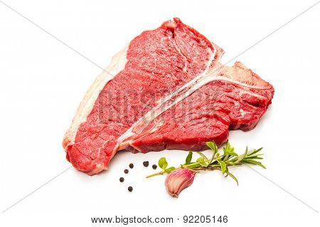 Raw fresh meat T-bone steak and seasoning isolated on white background