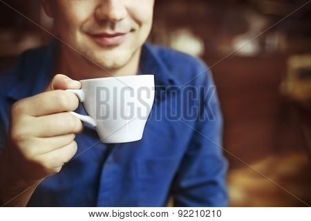 Man Drinking White Tea Cup In Cafe