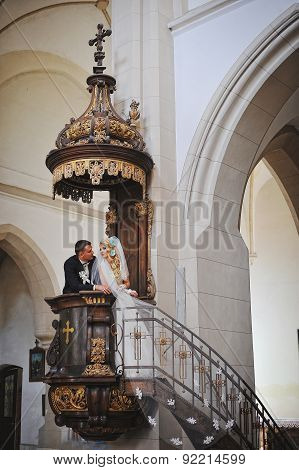 Young Beautiful Wedding Couple At The Old Catholic Church