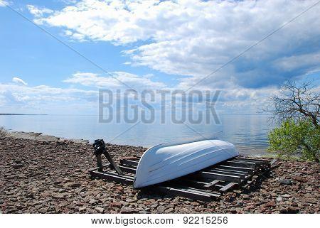 Coastline With A White Boat