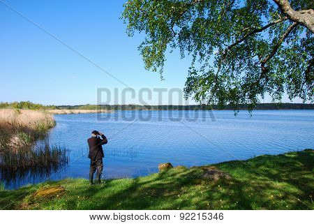 Birdwatching By A Calm Lake
