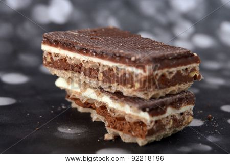 Picture of a Chocolate and vanilla waffers on a dark background