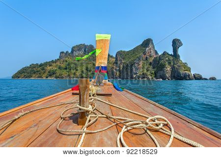 Longtail boat driving to the Chicken island in Andaman sea, Thailand
