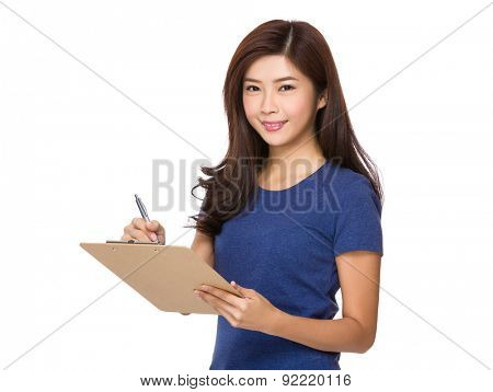 Young woman jot down something on clipboard