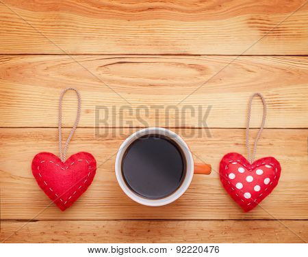 Valentine day love beautiful. Cup of coffee hearts on wood table