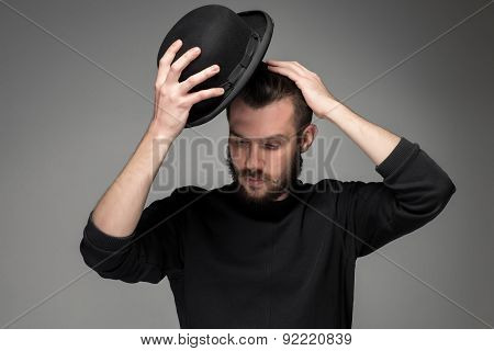 Young man raising his hat  in respect and admiration for someone