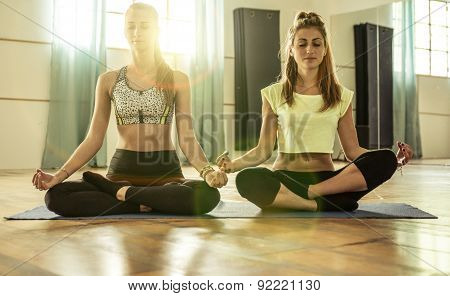 Couple Of Girls Making Yoga