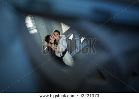 Kissing couple in love standing on a ladder
