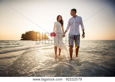 Bride And Groom Walk Barefoot At Spit
