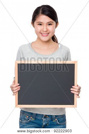 Young lady show with blank of balck board