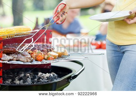 Woman Serving Grilled Steak