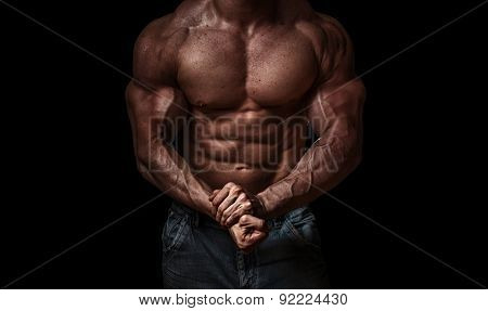 Bodybuilder Isolated On Black Background. Strong - Hard Muscle