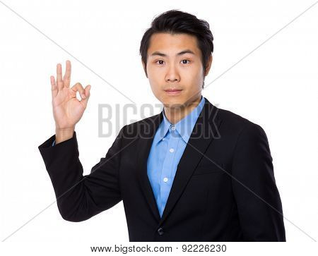Asian businessman with ok sign geature