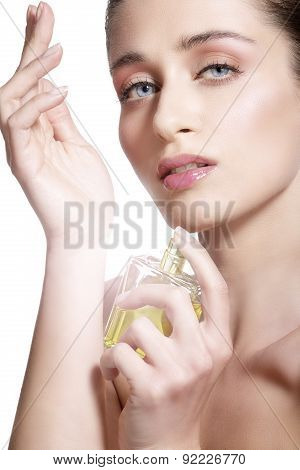 Beautiful Young Model Spraying A Flowers Fragrance On Her Body