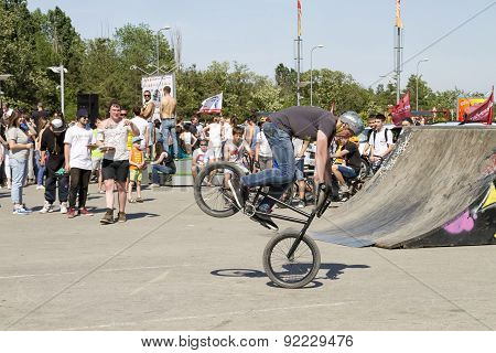 The Athlete Is An Extreme Sports Enthusiast Performs A Trick On A Bmx Bike With A Rotation On The Fr