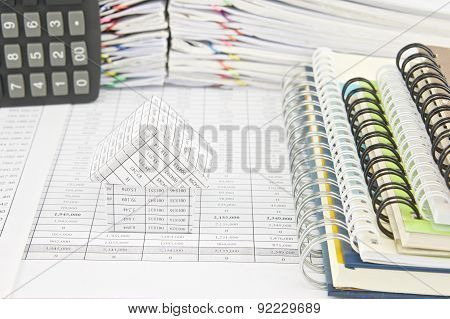 House And Notebook With Calculator On Finance Account