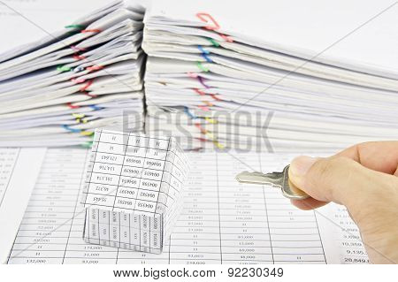Man Holding Silver Key And House On Finance Account